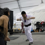 Ling Jiang from New York perform Iron Throat. Bending 3 iron rods.